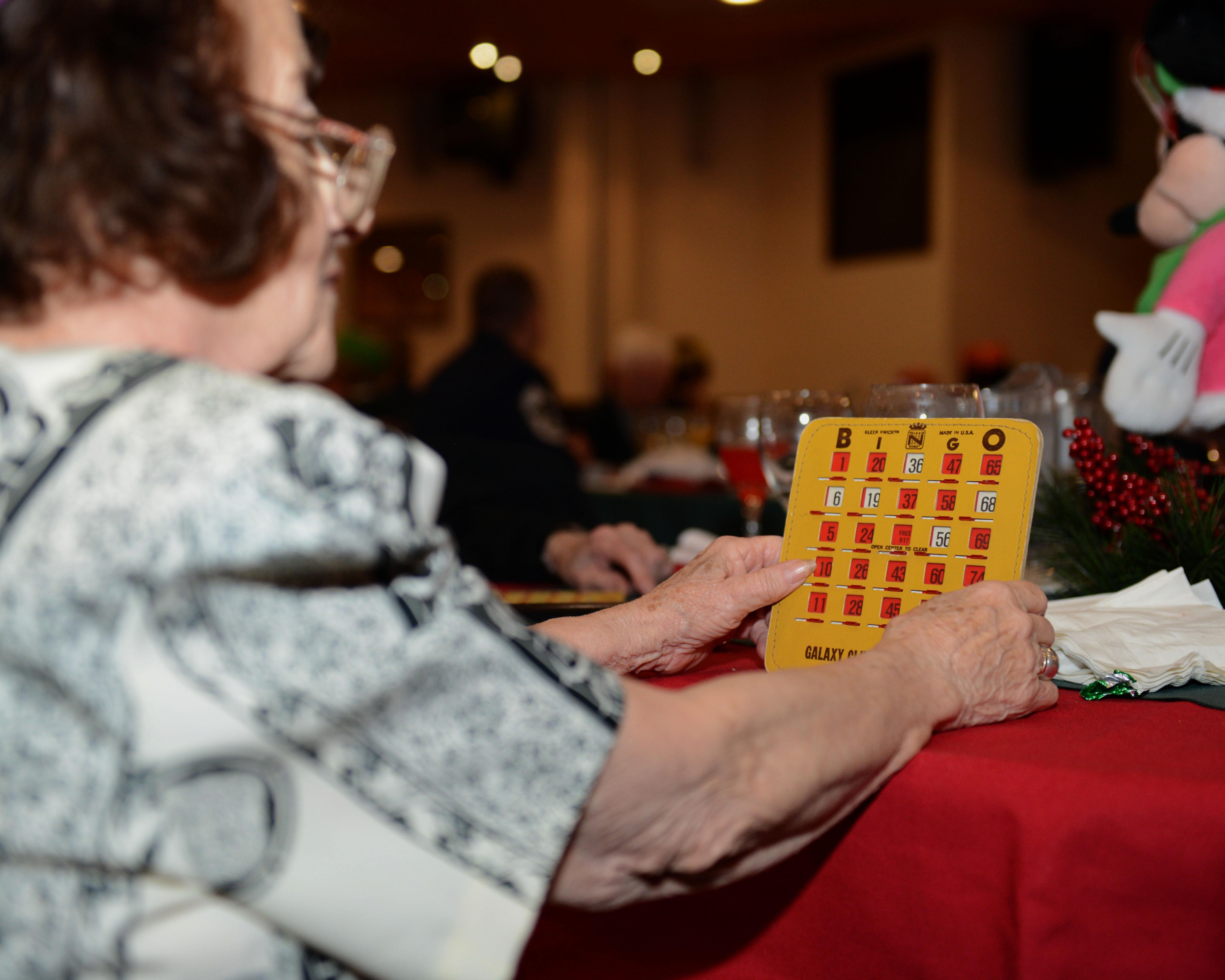 Christmas Party Ideas For Senior Citizens Part - 41: A Senior Citizen Plays Bingo Dec. 12, 2013, At The Senior Citizensu0027