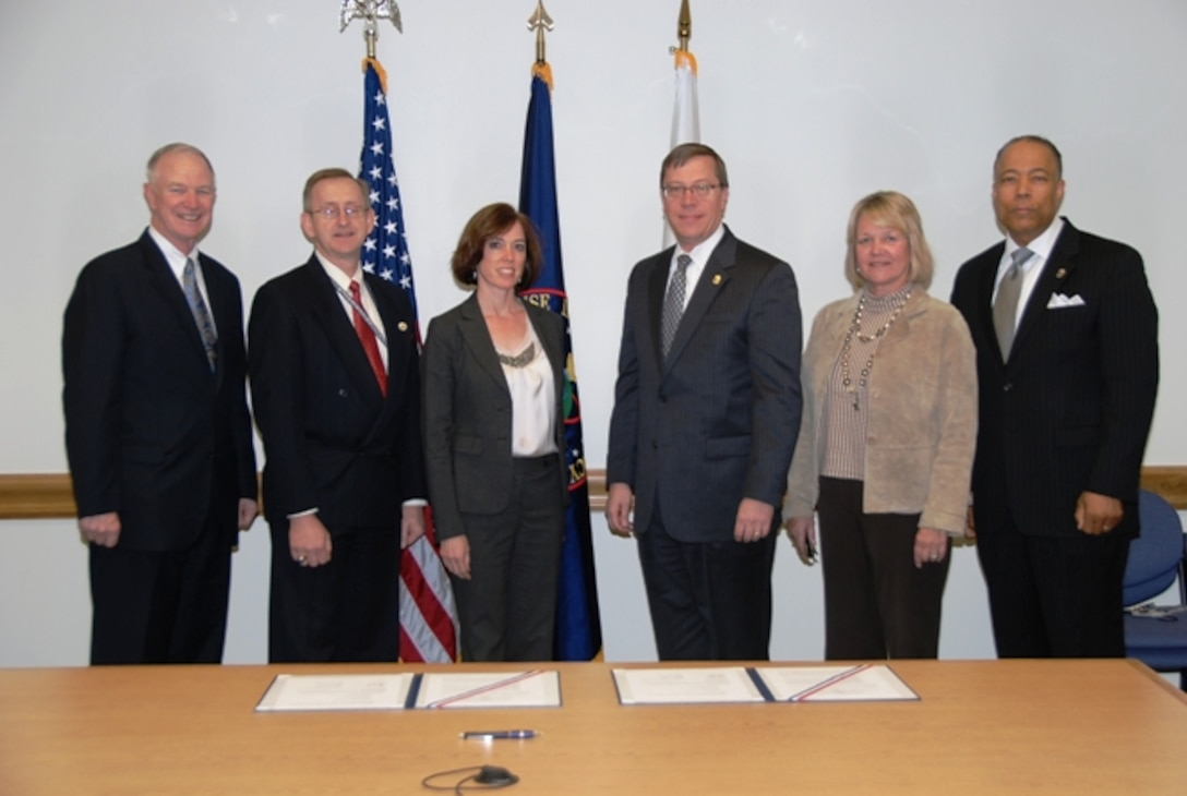 """This agreement adds a valuable new perspective to classroom discussion — that of law enforcement intelligence — to build on our education,"" said Dr. David Ellison, NIU president. ""DEA plays an integral part in national security, homeland security, law enforcement and counterterrorism."" Pictured from left to right: Dr. David Ellison; Dr. Barry Zulauf, Office of the Director of National Intelligence chair to NIU; Julie Mendosa '09, DEA chair to NIU; Assistant Administrator Rodney Benson, chief of intelligence for the DEA; Dr. Susan Studds, NIU provost; and William Walker '02, deputy assistant administrator, DEA Office of Intelligence."