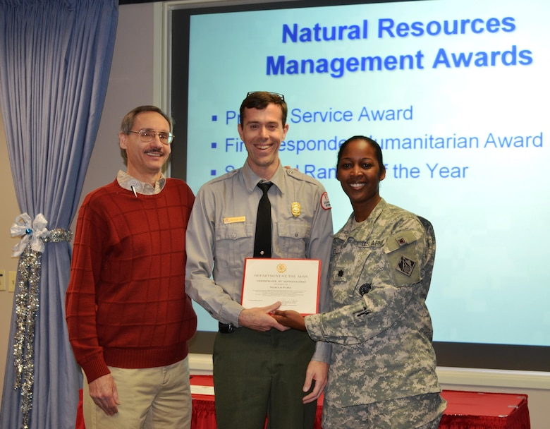ALBUQUERQUE, N.M., -- Cochiti Park Ranger Nicholas Parks received the First Responder Humanitarian of the Year award during the District's quarterly town hall meeting, Dec. 12, 2013. (l-r): Mark Yuska, Operations Division Chief, Nicholas Parks, District Commander Lt. Col. Antoinette Gant.