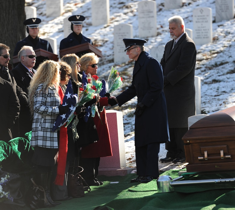 Family and friends of Col. Francis J. McGouldrick Jr. pay tribute to him as he is laid to rest Dec. 13, 2013, at Arlington National Cemetery, Va. McGouldrick was missing in action since 1968 when his plane collided with another plane. His remains were found in a remote jungle in Laos. (U.S. Air Force photo/Airman 1st Class Nesha Humes)