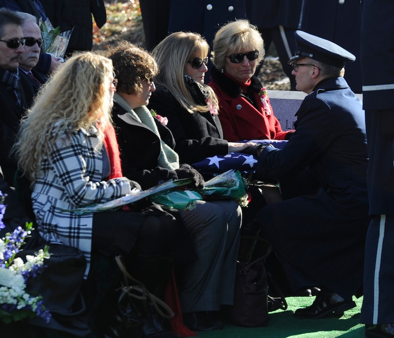 A flag was presented to the family of Col. Francis J. McGouldrick Jr. during his funeral Dec. 13, 2013, at Arlington National Cemetery, Va. McGouldrick was missing in action since 1968 when his plane collided with another plane. His remains were found in a remote jungle in Laos. (U.S. Air Force photo/Airman 1st Class Ryan J. Sonnier)