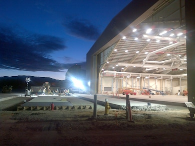 "KIRTLAND AIR FORCE BASE, N.M., -- ""Placing concrete before sunrise using the lights of the new Fuel Cell Maintenance Hangar."" This photo placed second based on employee voting. Photo by Jacob Chavez, July 18, 2013."