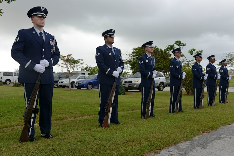 The base honor guard team lowers the flag to half-staff during the Linebacker II ceremony Dec. 13, 2013, on Andersen Air Force Base, Guam. The flag will be at half-staff for 11 days, representing Operation Linebacker II, which led to the end of the Vietnam War in 1972. (U.S. Air Force photo by Airman 1st Class Emily A. Bradley/Released)