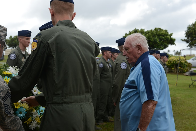 """Retired Lt. Col. Charles """"Chuck"""" McManus watches as the ceremonial wreath is placed during the Linebacker II ceremony Dec. 13, 2013, on Andersen Air Force Base, Guam. McManus was a B-52 Stratofortress navigator during Operation Linebacker II in 1972, which led to the end of the Vietnam War. (U.S. Air Force photo by Airman 1st Class Emily A. Bradley/Released)"""