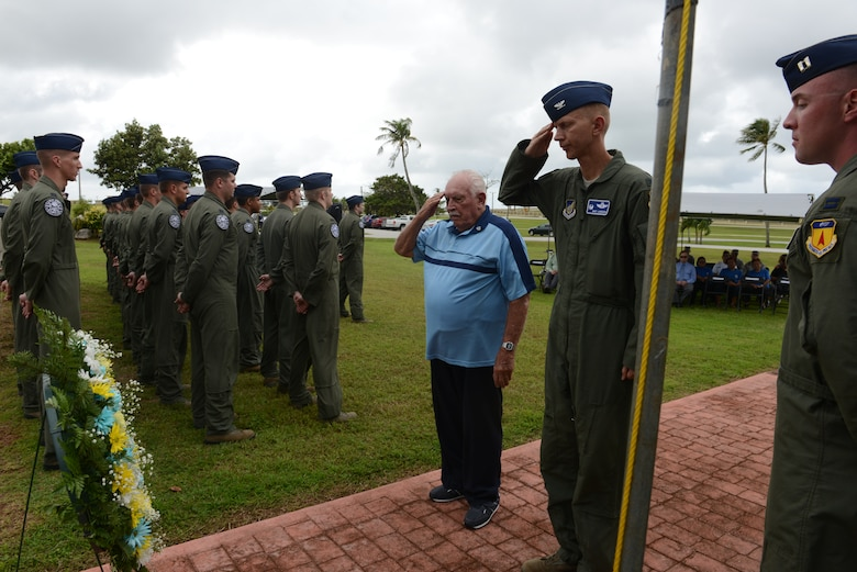 """Retired Lt. Col. Charles """"Chuck"""" McManus and Col. Reid Langdon, 36th Operations Group commander, render salutes after laying a wreath at the Linebacker II ceremony Dec. 13, 2013, on Andersen Air Force Base, Guam. The ceremony honored the sacrifices the service members made and observed the 41st year of Operation Linebacker II, which led to the end of the Vietnam War. (U.S. Air Force photo by Airman 1st Class Emily A. Bradley/Released)"""