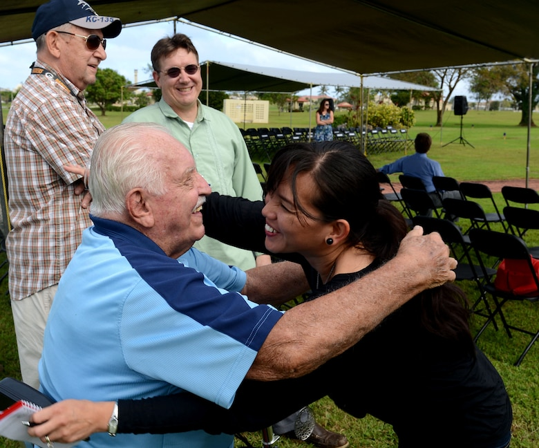 """Retired Lt. Col. Charles """"Chuck"""" McManus hugs an attendee prior to the Linebacker II ceremony Dec. 13, 2013, on Andersen Air Force Base, Guam. McMamus was a B-52 Stratofortess navigator during Operation Linebacker II. (U.S. Air Force photo by Airman 1st Class Emily A. Bradley/Released)"""