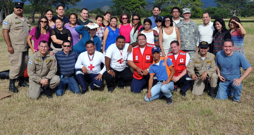 """Members of Joint Task Force-Bravo, the Honduran Academy of Pediatrics, the Honduran Red Cross, Honduran first responders, and members of the Permanent Contingency Commission of Honduras (COPECO) pose for a photo at the completion of an American Academy of Pediatric Disaster """"Train the Trainer"""" course at Soto Cano Air Base, Honduras, Dec. 13, 2013. The three-day course provided training in the planning for and care of pediatric populations post-disaster. (U.S. Air Force photo by Capt. Zach Anderson)"""