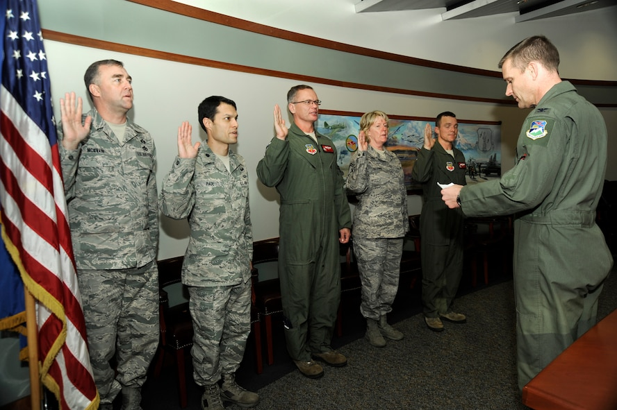 Col. Rick Wedan, 142nd Fighter Wing Commander, (right) administers the oath to the new Wing assessment and management team that will help conduct inspections using the Management Internal Control Toolsets (MICT), Dec. 3, 2013 at the Portland Air National Guard Base, Ore. Members include (Left to right) Chief Master Sgt. John McIlvain, Lt. Col. Frank Page, Lt. Col. Bill Kopp, Senior Master Sgt. Linda Baugher and Lt. Col. Sean Sullivan.  (Air National Guard photo by Tech. Sgt. John Hughel, 142nd Fighter Wing Public Affairs/Released)