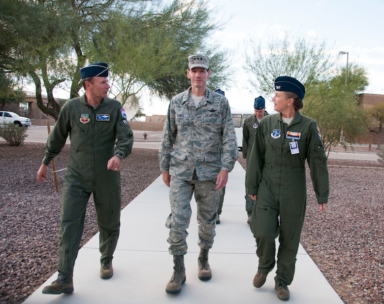Maj. Gen. Gregory J. Schwab, left, Air National Guard Assistant to the Commander, Air Combat Command, Lt. Gen. Stanley E. Clarke III, director of the Air National Guard, and Col. Bobbie Doorenbos, Commander of the 214th Reconnaissance Group walks to facilities at the 214th Reconnaissance Group, Davis-Monthan Air Force Base, Ariz., Dec. 13, 2013. The visit is Clarke's first to the Arizona Air Guard since becoming director. During the visit, Clarke met with Airmen from 162nd Fighter and the 214th Reconnaissance Group. (U.S. Air National Guard photo by Staff Sgt. Dina Farmer/Released)