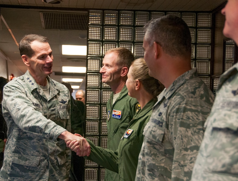 Lt. Gen. Stanley E. Clarke III, director of the Air National Guard, greets the leadership of the 162nd Fighter Wing, during a visit to Tucson, Ariz., Dec. 13, 2013. The visit is Clarke's first to the Arizona Air Guard since becoming director. During the visit, Clarke met with Airmen from 162nd Fighter and the 214th Reconnaissance Group. (U.S. Air National Guard photo by Staff Sgt. Dina Farmer/Released)