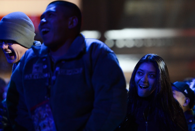Audience members react to a joke by comedian Jeff Dunham, Dec. 11, 2013, at the the WWE Tribute to the Troops event at Joint Base Lewis-McChord, Wash. Approximately 4,000 service members and family members were treated to the event featuring 40 WWE superstars and divas. (U.S. Air Force photo/Tech. Sgt. Sean Tobin)