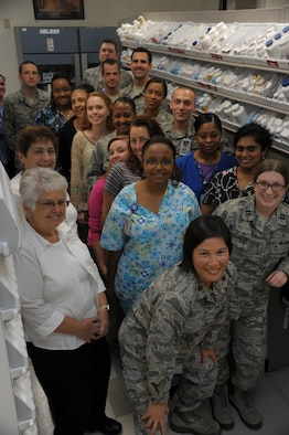 Maxwell's pharmacy poses for a group photo, Nov. 6. Filling more than 1,500 prescriptions daily, the staff of Airmen and civilians operate the second busiest pharmacy within Air Education and Training Command, according to pharmacy leadership.(U.S. Air Force photo by Airman 1st Class William Blankenship)