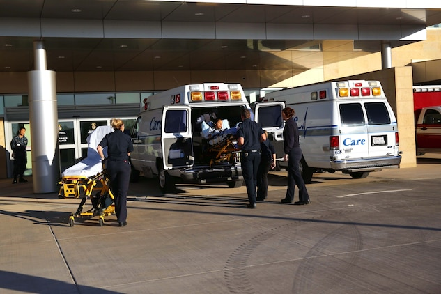 After being transported, Lance Cpl. Lucia Cabral is lowered from an ambulance by emergency medical technicians. The Naval Hospital Camp Pendleton facility, built in 1969, was officially decommissioned, requiring patients to be relocated to Pendleton's recently built, 500,000-square foot, replacement hospital Dec. 14. The four-floor building cost $456 million and took more than three years to construct. Cabral is a maintenance management specialist with1st Marine Logistics Group.