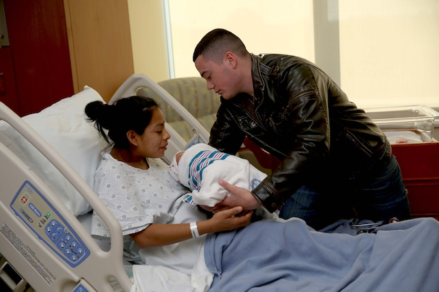 Pfc. Nicholas M. Cabral and wife, Lance Cpl. Lucia Y. Cabral, take turns holding their newborn baby at Camp Pendleton's newest hospital. The Naval Hospital Camp Pendleton facility, built in 1969, was officially decommissioned, requiring patients to be relocated to Pendleton's recently built, 500,000-square foot, replacement hospital Dec. 14. The four-floor building cost $456 million and took more than three years to construct. Lucia is a maintenance management specialist and Nicholas is a warehouse clerk with1st Marine Logistics Group.