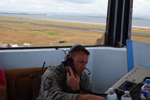 Master Sgt. Clinton Dykes, 36th Contingency Response Group air traffic control NCO in charge, mans the air traffic control tower during Operation Damayan in Tacloban, Philippines, Nov. 16, 2013. Operation Damayan is a U.S. humanitarian aid and disaster relief effort that supported the Philippines in the wake of the devastating effects of Typhoon Haiyan. (Courtesy photo)