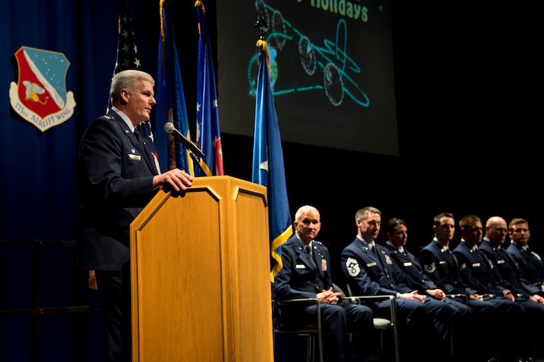 Col. Jim Johnson, left, 133rd Airlift Wing Commander gives his holiday address to Airmen of the 133rd Airlift Wing during the annual Wing Awards Ceremony in St. Paul, Minn., Dec 14, 2013. The award ceremony recognizes outstanding Airmen throughout the wing. (U.S. Air National Guard photo by Staff Sgt. Austen Adriaens/Released)