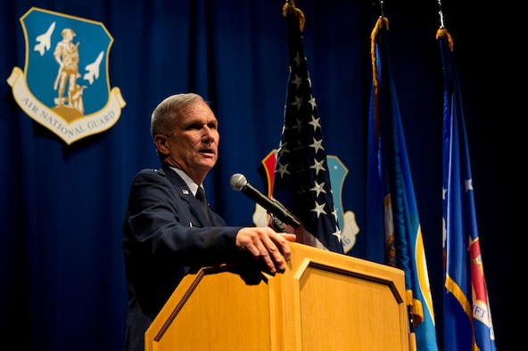 Brig. Gen. Robert Cayton, left, Commander of the Minnesota Air National Guard and Chief of Staff Joint Forces Headquarters gives his holiday address to Airmen of the 133rd Airlift Wing during the annual Wing Awards Ceremony in St. Paul, Minn., Dec 14, 2013. The award ceremony recognizes outstanding Airmen throughout the wing. (U.S. Air National Guard photo by Staff Sgt. Austen Adriaens/Released)