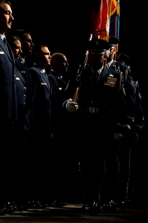 The 133rd Airlift Wing Honor Guard takes the stage during the annual Wing Awards Ceremony in St. Paul, Minn., Dec 14, 2013. These Airmen perform at ceremonies and events all over the state of Minnesota. (U.S. Air National Guard photo by Staff Sgt. Austen Adriaens/Released)