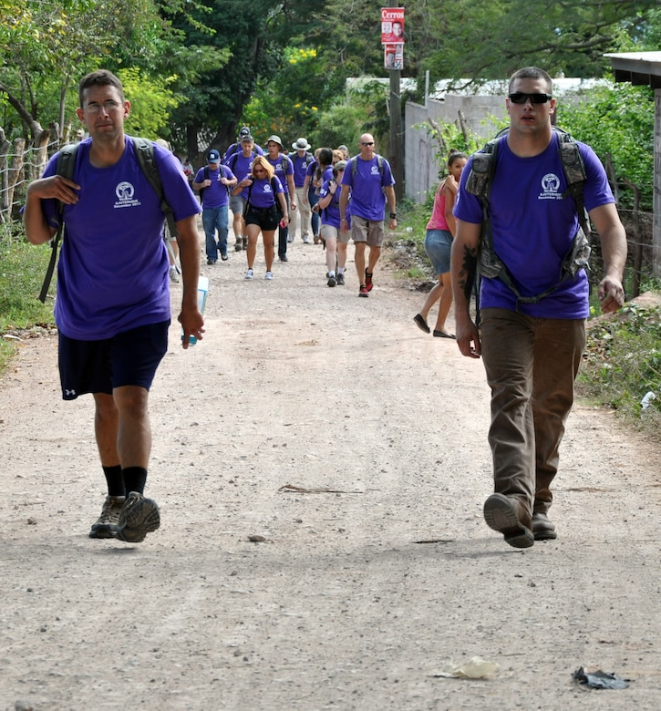 Members of Joint Task Force-Bravo make the three-mile hike to the village of Ajuterique in the Department of Comayagua, Honduras, as part of the 51st Joint Task Force Bravo Chapel Hike, Dec. 14, 2013.  The Task Force members delivered more than 100 packs of food to families in need in the community, then spent the remainder of their working on a housing project in Ajuterique, doing manual labor to help build homes for families.  (U.S. Air Force photo by Capt. Zach Anderson)