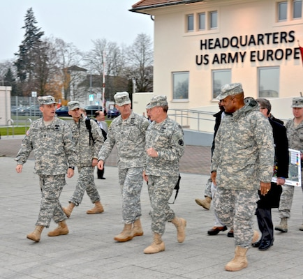 WIESBADEN, Germany – The Chairman of the Joint Chiefs of Staff, Gen. Martin E. Dempsey, is escorted by the U.S. Army Europe Deputy Commanding General, Maj. Gen. Richard C. Longo, and USAREUR Senior Enlisted Advisor, Command Sgt. Maj. David S. Davenport, during a visit to USAREUR Headquarters on Clay Kaserne, Dec. 12. Dempsey's visit to USAREUR concludes the seven-day, four-country USO Chairman's Holiday Tour. This is his first visit to Clay Kaserne since USAREUR HQ relocated here from Heidelberg. (Photo by Karl Weisel, U.S. Army Garrison Wiesbaden Public Affairs Office)
