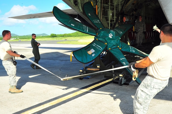 Reservists from the 403rd Wing, Keesler Air Force Base, Miss., load a propeller onto a WC-130J at Henry E. Rohlsen Airport, St. Croix, U.S. Virgin Islands, Dec. 12, 2013. Aircrews from the 53rd Weather Reconnaissance Squadron, known as the Hurricane Hunters, forward deploy to St. Croix to fly storms on the Atlantic side during hurricane season.