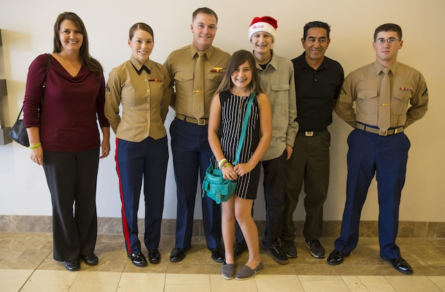 Jared and his family stand with the Marines from Camp Pendleton during his Make-A-Wish wish at the Westfield North County Mall. The Marines escorted Jared through the mall during his shopping-spree and answered many Marine Corps related questions the 15-year-old had.