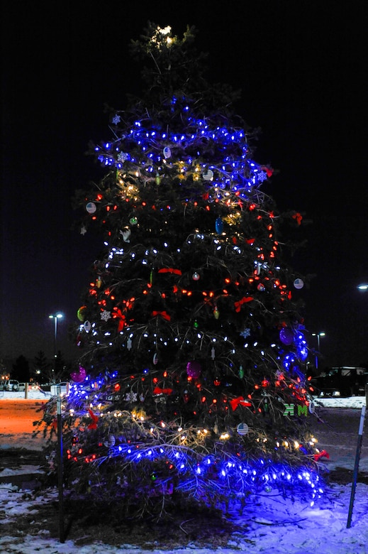 A tree is lit Dec. 9, 2013, on Buckley Air Force Base, Colo., during a tree-lighting ceremony in memory of Kristopher Mansfield, a former 460th Space Communications Squadron Airman who was killed by a drunk driver. Family and friends decorate the tree in celebration of Mansfield's life and what he meant to the squadron. (U.S. Air Force photo by Airman 1st Class Samantha Saulsbury/Released)