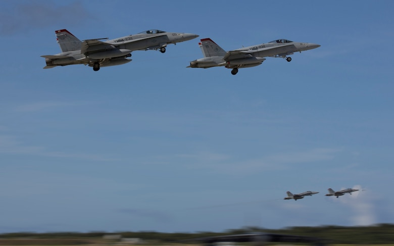 U.S. Marines with Marine Fighter Attack Squadron (VMFA)-232, fly F/A-18C Hornets from Andersen Air Force Base, Guam, during Exercise Forager Fury II Dec. 9, 2013. VMFA-232 is currently assigned to Marine Aircraft Group (MAG)-12, 1st Marine Aircraft Wing (1st MAW), while participating in unit deployment program. Forager Fury improves the aviation combat readiness of MAG-12 and 1st MAW and simulates operations in a deployed environment. (U.S. Marine Corps photo by Lance Cpl. Richard Currier/Released)