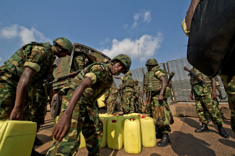 Burundi soldiers load their gear at the Bangui Airport, Central Africa Republic, Dec. 13, 2013. In coordination with the French military and African Union, the U.S. military provided airlift support to transport Burundi soldiers, food and supplies in the CAR. This support is aimed at enabling African forces to deploy promptly to prevent further spread of sectarian violence and restore security in CAR. (U.S. Air Force photo/Staff Sgt. Erik Cardenas)
