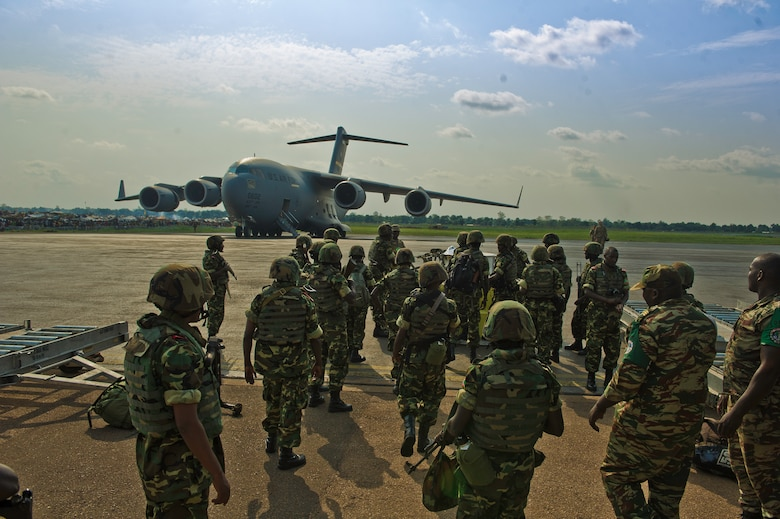 Burundi soldiers gather their gear at the Bangui Airport, Central Africa Republic, Dec. 13, 2013. In coordination with the French military and African Union, the U.S. military provided airlift support to transport Burundi soldiers, food and supplies in the CAR. This support is aimed at enabling African forces to deploy promptly to prevent further spread of sectarian violence and restore security in CAR. (U.S. Air Force photo/Staff Sgt. Erik Cardenas)