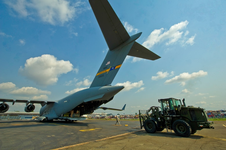U.S. Air Force members unload cargo off a C-17 Globemaster Dec. 13, 2013 at Bangui Airport, Central Africa Republic. In coordination with the French military and African Union, the U.S. military provided airlift support to transport Burundi soldiers, food and supplies in the CAR. This support is aimed at enabling African forces to deploy promptly to prevent further spread of sectarian violence and restore security in CAR. (U.S. Air Force photo/Staff Sgt. Erik Cardenas)