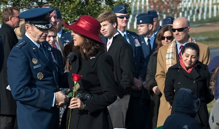 Gen. Robin Rand, Air Education and Training Command commander, speaks with Ginger Gilbert Ravella, after her late husband???s, Maj. Troy Gilbert, remembrance funeral at Arlington Cemetery, Dec. 11, 2013. Gilbert was at one time an executive officer for Rand and had flown with him in the past.  (U.S. Air Force photo by Staff Sgt. Carlin Leslie)