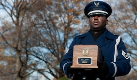 A member of the U. S. Air Force Honor Guard carries the recently recovered remains of Maj. Troy Gilbert, during a remembrance funeral seven years to the day of his first military burial at Arlington Cemetery, Dec. 11, 2013. (U.S. Air Force photo by Staff Sgt. Carlin Leslie)