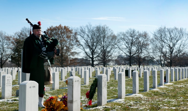 Norm Weaver, bagpiper, gives a performance during Maj. Troy Gilberts??? remembrance funeral at Arlington Cemetery, Dec. 11, 2013. Gilbert was an F-16 Fighting Falcon pilot whose aircraft crashed on Nov. 27, 2006 during Operation Iraqi Freedom.  (U.S. Air Force photo by Staff Sgt. Carlin Leslie)