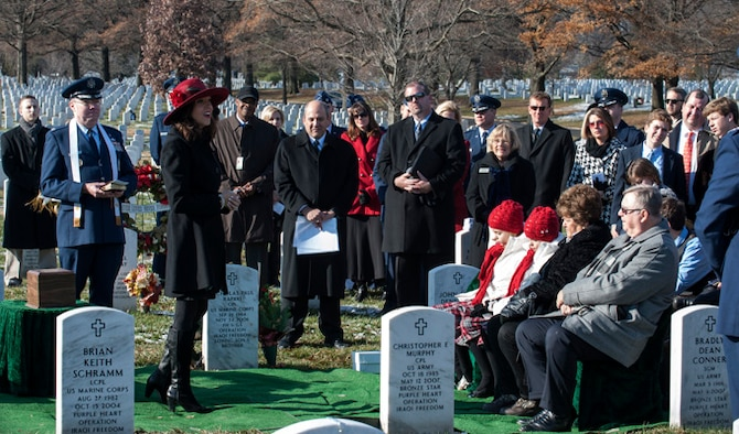 Ginger Gilbert Ravella, speaks during her late husband, Maj. Troy Gilberts??? remembrance funeral at Arlington Cemetery, Dec. 11, 2013. Gilbert was an F-16 Fighting Falcon pilot whose aircraft crashed on Nov. 27, 2006 during Operation Iraqi Freedom. (U.S. Air Force photo by Staff Sgt. Carlin Leslie)