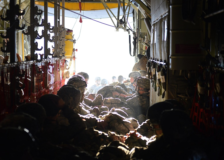 Paratroopers from the 1st Batallion, 503rd Infantry Regiment, 173rd Airborne Brigade Combat Team, prepare for takeoff in the back of a C-130 Hercules, Dec. 11, 2013, at Aviano Air Base, Italy. Airmen from Ramstein Air Base, Germany, partnered with soldiers from U.S. Army at Vicenza to conduct airfield seizure training operations on Rivolta Italian air force base.