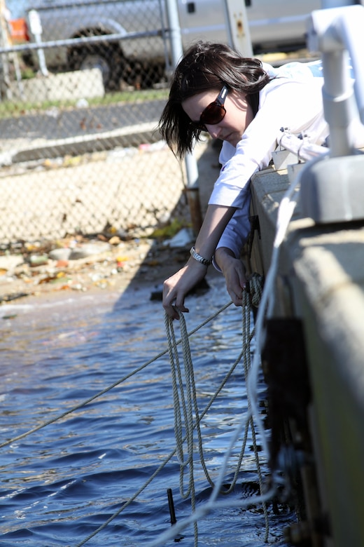 Kristen Donofrio, a biological scientist with the Norfolk District, U.S. Army Corps of Engineers, ties oyster floats to Fort Norfolk's pier Oct. 16, 2011.