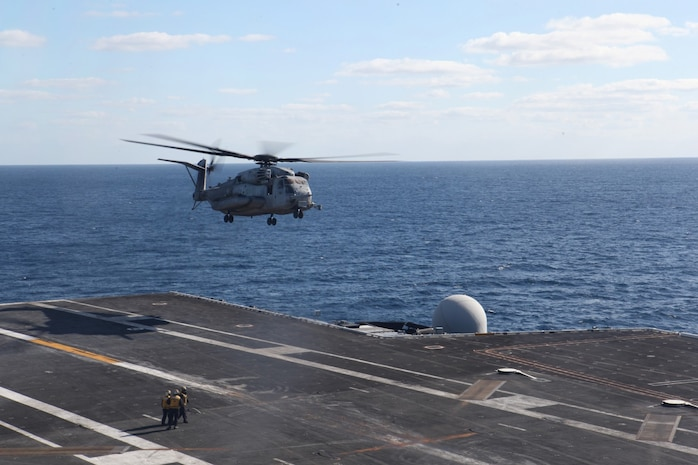 Marines with Marine Heavy Helicopter Squadron 361 depart the USS Ronald Reagan off the coast of San Diego, Calif., Dec. 6. Marines flew from Camp Pendleton to the aircraft carrier to conduct rotary wing operations.