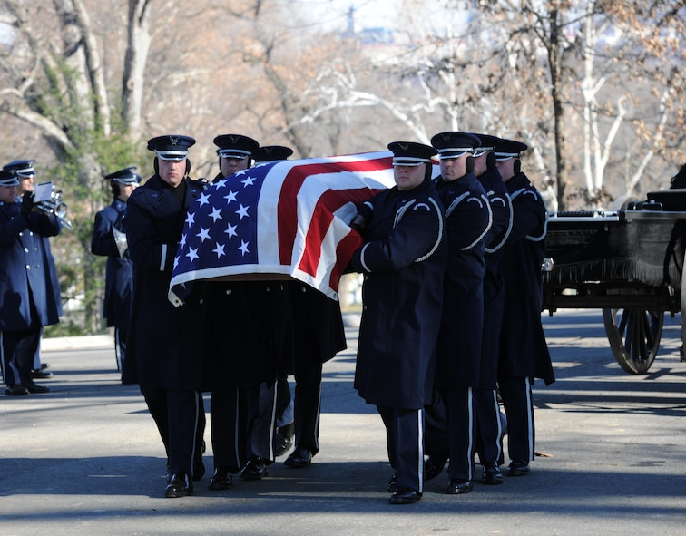 U.S. Air Force Honor guardsmen carry Col. Francis J. McGouldrick Jr.'s casket to his final resting place Dec. 13, 2013, at Arlington National Cemetery, Va. McGouldrick was missing in action since 1968 when his plane collided with another plane. His remains were found in a remote jungle in Laos. (U.S. Air Force photo/Airman 1st Class Nesha Humes)