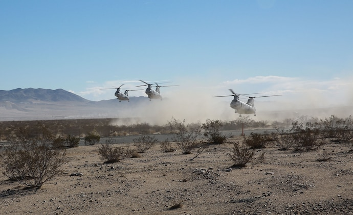Three CH-46 Sea Knight helicopters prepare to drop off Marines during an air raid in support of Exercise Steel Knight 2014 at Marine Corps Air Ground Combat Center Twentynine Palms, Calif., Dec. 11th, 2013. After landing, the Marines set up blocking positions and secured the airfield. The training developed important skills and tactics necessary for their upcoming deployment to Australia. Steel Knight is an annual exercise that includes elements from the entire I Marine Expeditionary Force that focuses on conventional operations and provides realistic training that prepares Marines for overseas operations. (Marine Corps photo by Lance Cpl. Jonathan Boynes/Released)