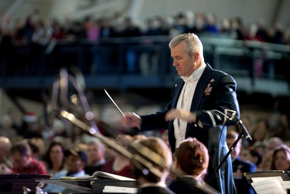 "Col. Larry Lang conducts the U.S. Air Force Band during the ""Spirit of the Season 2013"" concert Dec. 15, 2013, at the Smithsonian National Air and Space Museum, Udvar-Hazy Center, Chantilly, Va. The band partnered with the Smithsonian Air and Space Museum to hold two performances for museum guests. Lang is the Air Force Band commander and conductor. (U.S. Air Force photo/Staff Sgt. Carlin Leslie)"