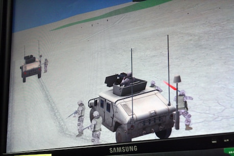 A battle scenario unfolds on the video screen in the combat convoy simulator at Camp Wilson.