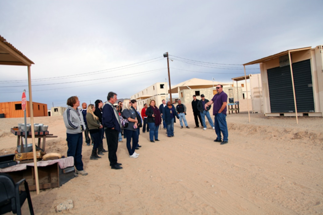 Tour guide Mike King explains to visitors how different training scenerios can unfold in MOUT — Military Operations in Urban Terrain — facilities like the Combat Center's Range 215.