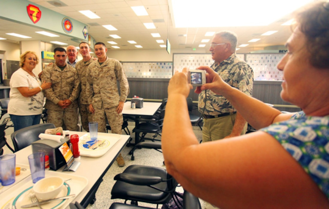 Tour participants often mingle with Marines and sailors during lunch at one of the Combat Center's dining facilities. Many take photos to remember the moment.