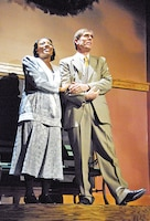 """Tiffany Stone, military spouse, left, sings alongside Monte Dibben, right, in the JCLT production of """"A Wonderful Life"""" during a dress rehearsal Dec. 4 at the C.L. Hoover Opera House, Junction City. Stone played Mary Hatch, the female lead, alongside Dibben, who played George Bailey.  Photo by: Julie Fiedler, POST."""