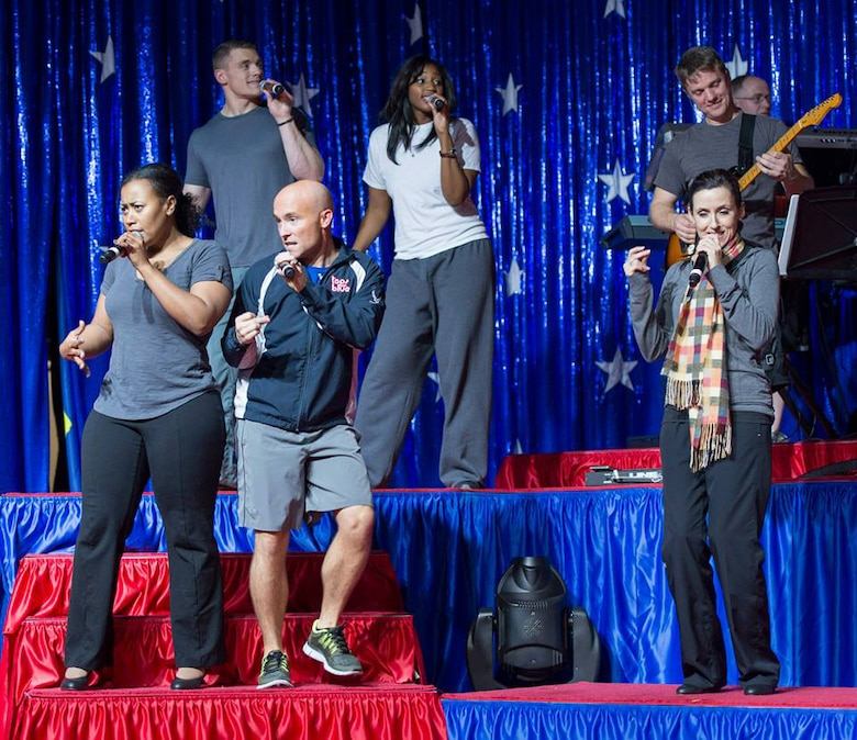 Staff Sgt. Jeffrey Collins, 4th Combat Camera Squadron, March Air Reserve Base, Calif., rehearses for the 2013 Tops in Blue All-Star tour, December 5, 2013 at Joint Base San Antonio, Texas . The Air Force's premier talent group formed the all-stars to celebrate the organization's 60th anniversary with a whirlwind holiday tour for the troops. (Photo downloaded from Tops In Blue Facebook page.)