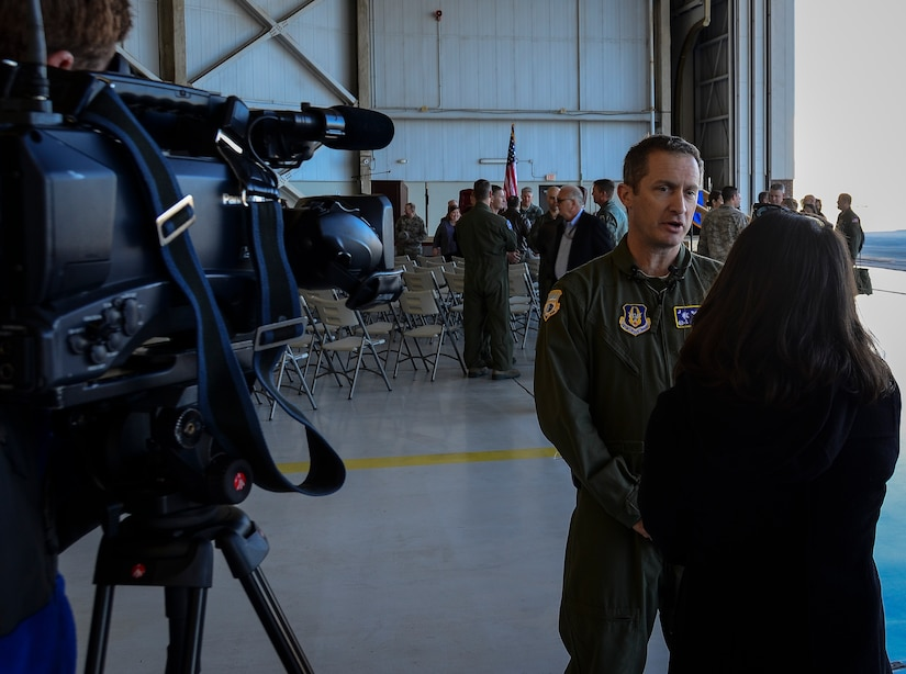 """Col. James Fontanella, 315th Airlift Wing commander, answers questions during an interview at the Aircraft 9192's 20,000 Flight Hours ceremony, December 18, 2013 at Joint Base Charleston – Air Base, S.C. The aircraft, nicknamed the """"Spirit of Charleston"""" was the first C-17 in the U.S. Air Force's inventory and has flown missions throughout the world for more than two decades. Those missions have totaled more than 20,000 flight hours. (U.S. Air Force photo/Staff Sgt. Anthony Hyatt)"""