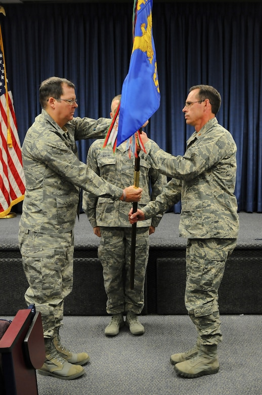 Col. Robert Hamm (left), commander of the 123rd Operations Group, presents the guidon of the 123rd Special Tactics Squadron to Maj. Sean McLane, the unit's new commander, during a change-of-command ceremony held at the Kentucky Air National Guard Base in Louisville, Ky., Nov. 24, 2013. The passing of the guidon is a time-honored tradition signifying change of leadership. (U.S. Air National Guard photo by Staff Sgt. Vicky Spesard)