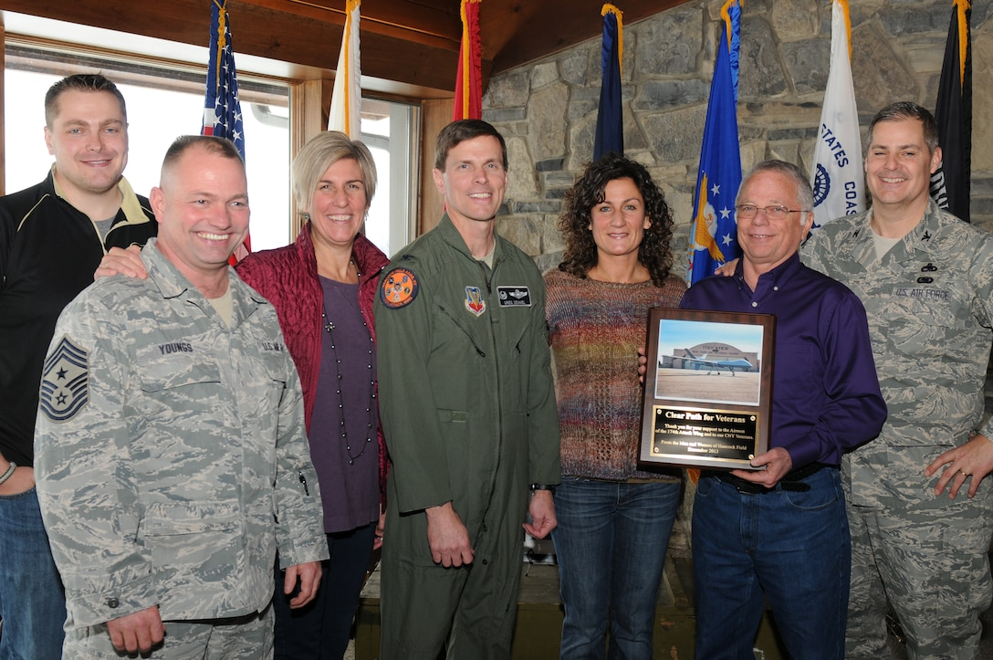 Col. Greg Semmel (Center), Commander of the 174th Attack Wing, Col. John Balbierer (Far Right), Vice Commander of the 174th Attack Wing and Chief Master Sgt. Russell Youngs (Left), Commander Chief Master Sgt. of the 174th Attack Wing, present a plaque to the members of Clear Path for Veterans on 18 Dec 2013. Clear Path  is a community based veteran's outreach center that is focused on helping both active duty and non-active duty veterans. (Photo by New York Air National Guard Senior Airman Duane Morgan)