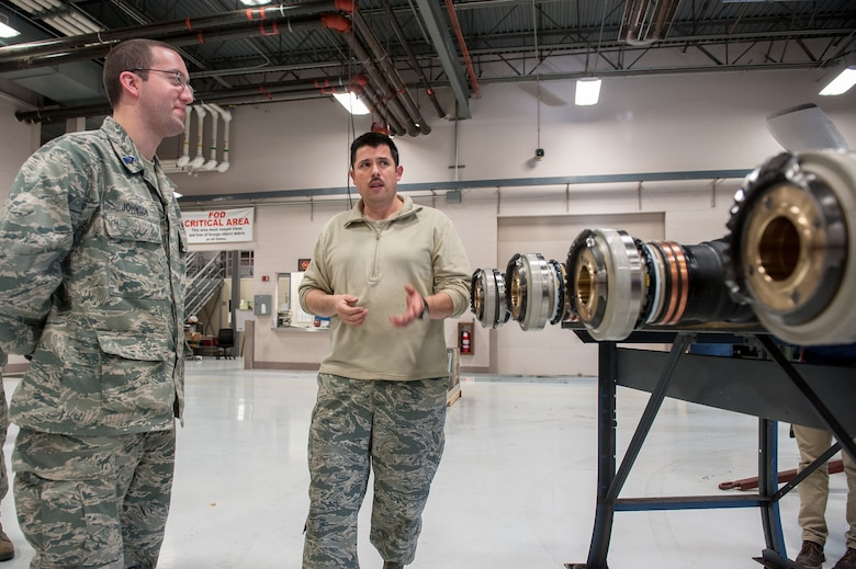 Tech. Sgt. Chuck Rodgers, an engine mechanic from the 123rd Maintenance Squadron, discusses C-130 propulsion systems with U.S. Air Force Reserve Officer Training Corps Cadet 3rd Class Trevor Johnson during a tour of the Kentucky Air National Guard Base in Louisville, Ky., Nov. 19, 2013. Johnson is assigned to Detachment 295, which is based at the University of Louisville. (U.S. Air National Guard photo by Maj. Dale Greer)
